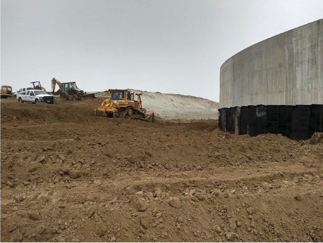 Martin Excavating placing backfill along the west side of the reservoir.