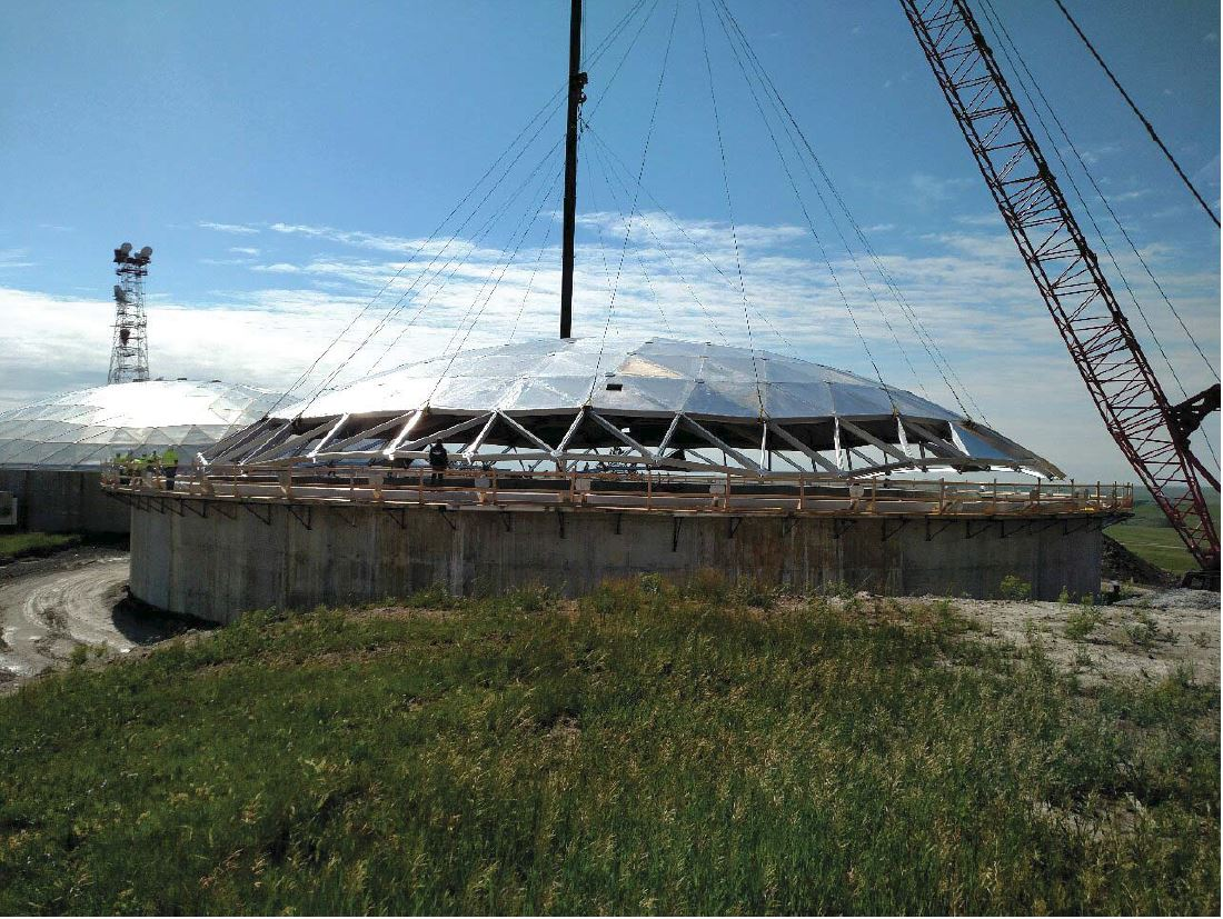 Looking east at the reservoir where the dome is being lifted above the reservoir walls to be put in place.