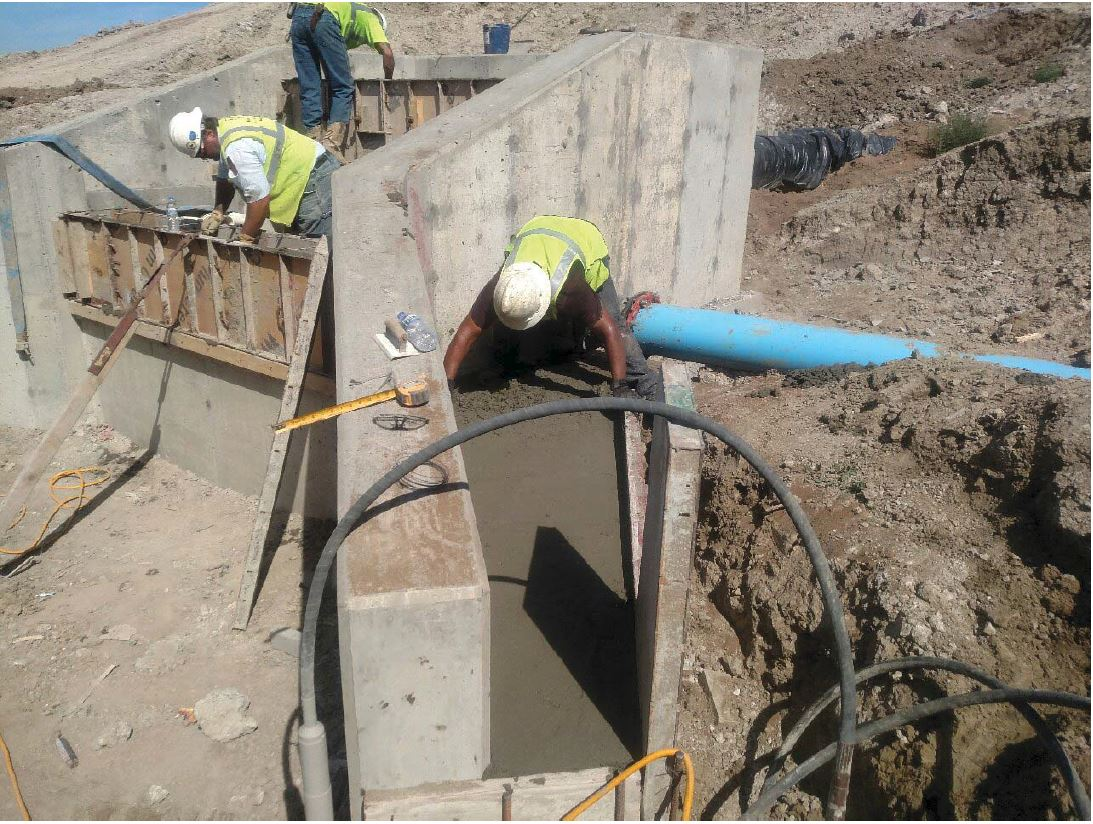 JTJ finishing the concrete at the overflow outlet structure.