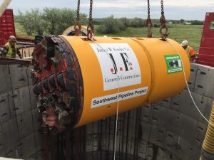 The microtunneling machine being lowered into the caisson.