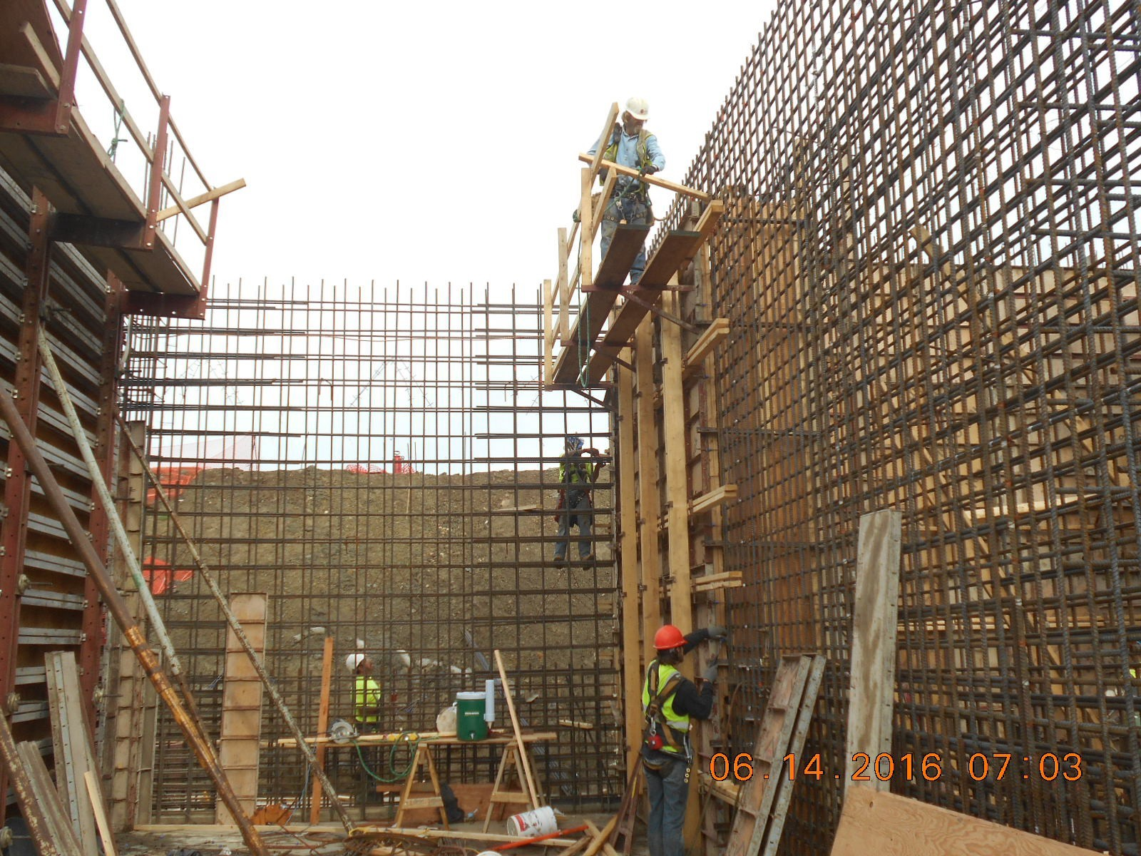 JTJ finishing bracing of wall forms for southwest corner of the Ozone Contact area.