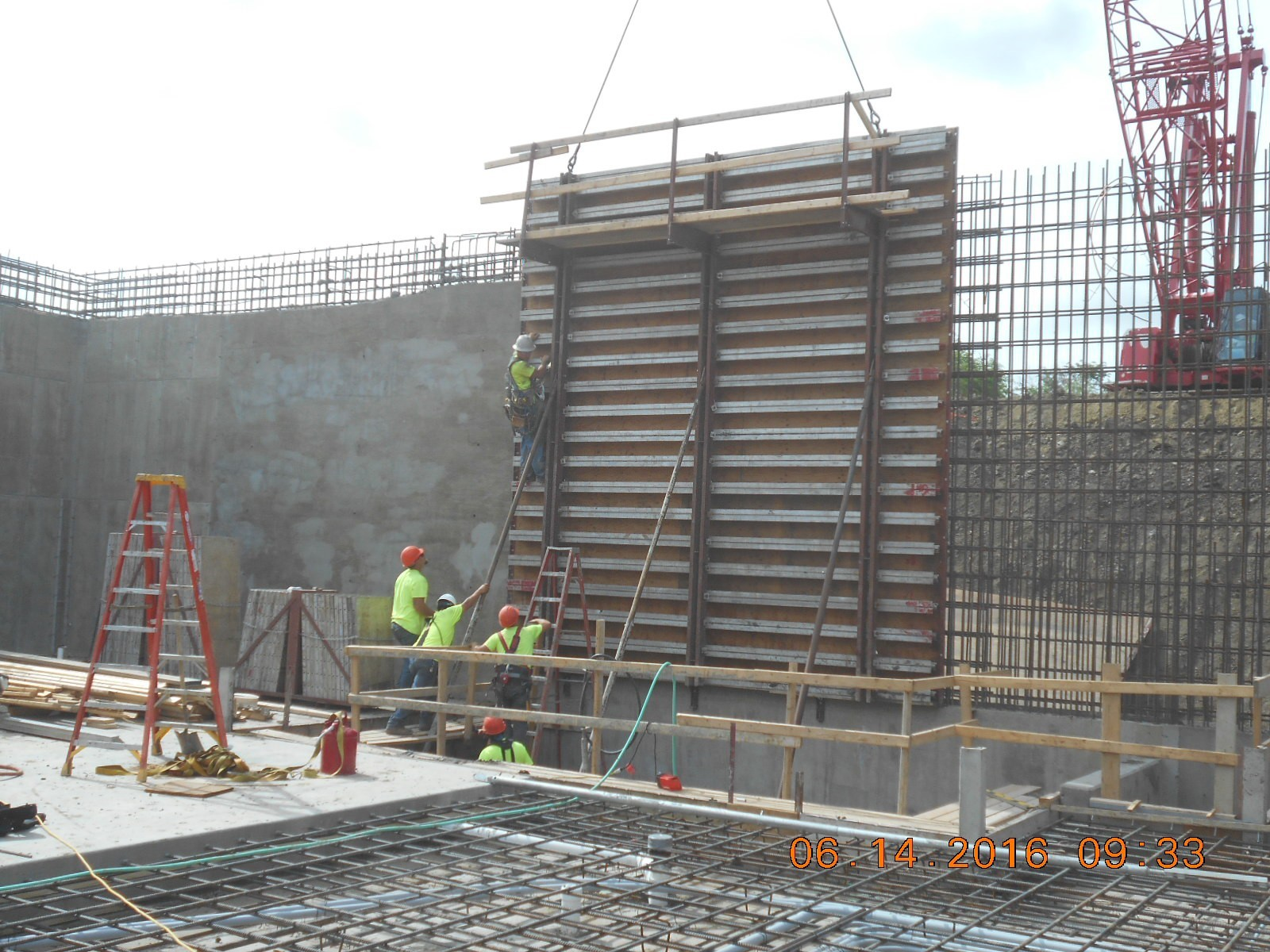 JTJ placing a gang form for the south exterior wall at the Coag Pit.
