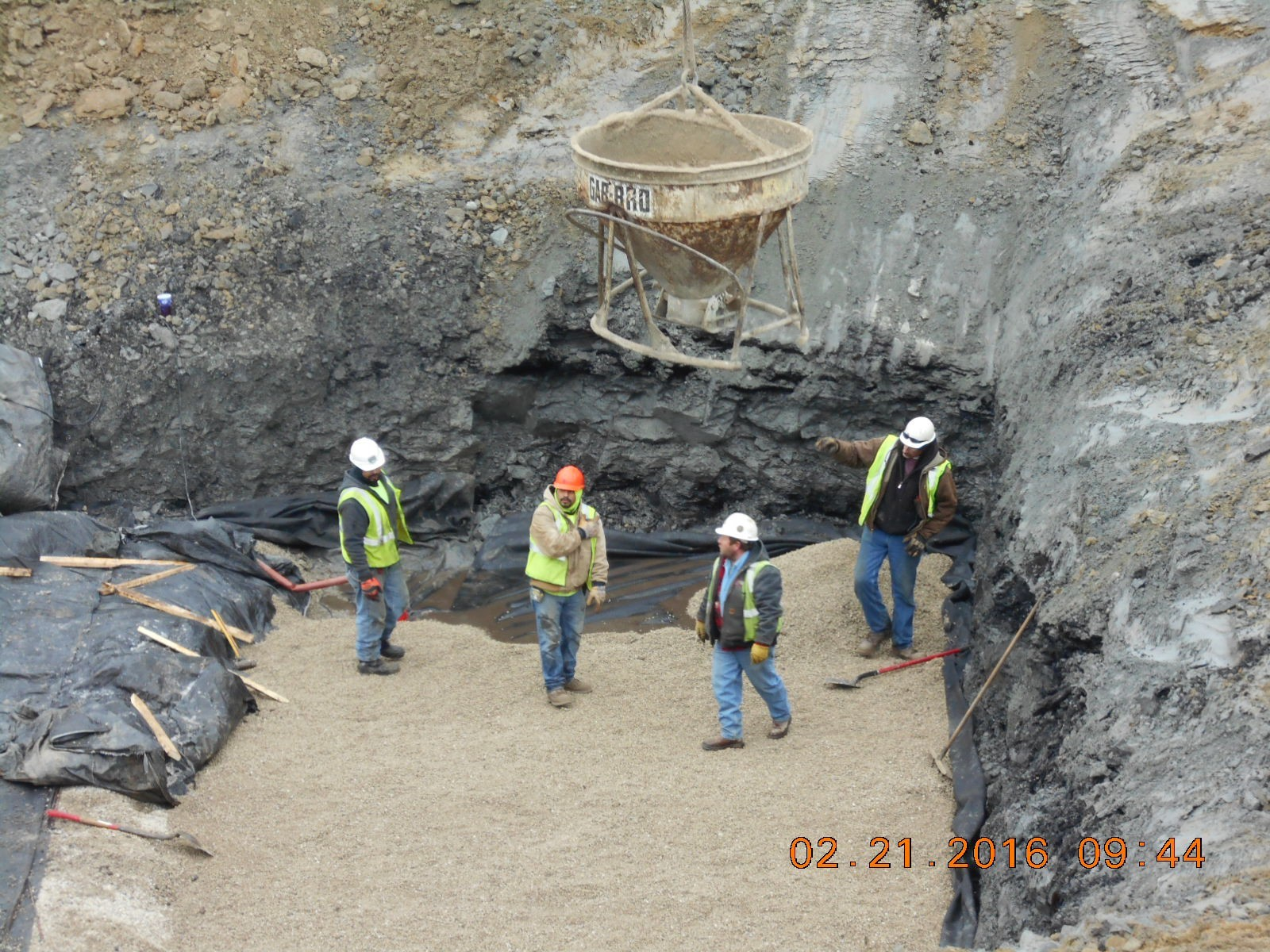 Crew placing rock base.