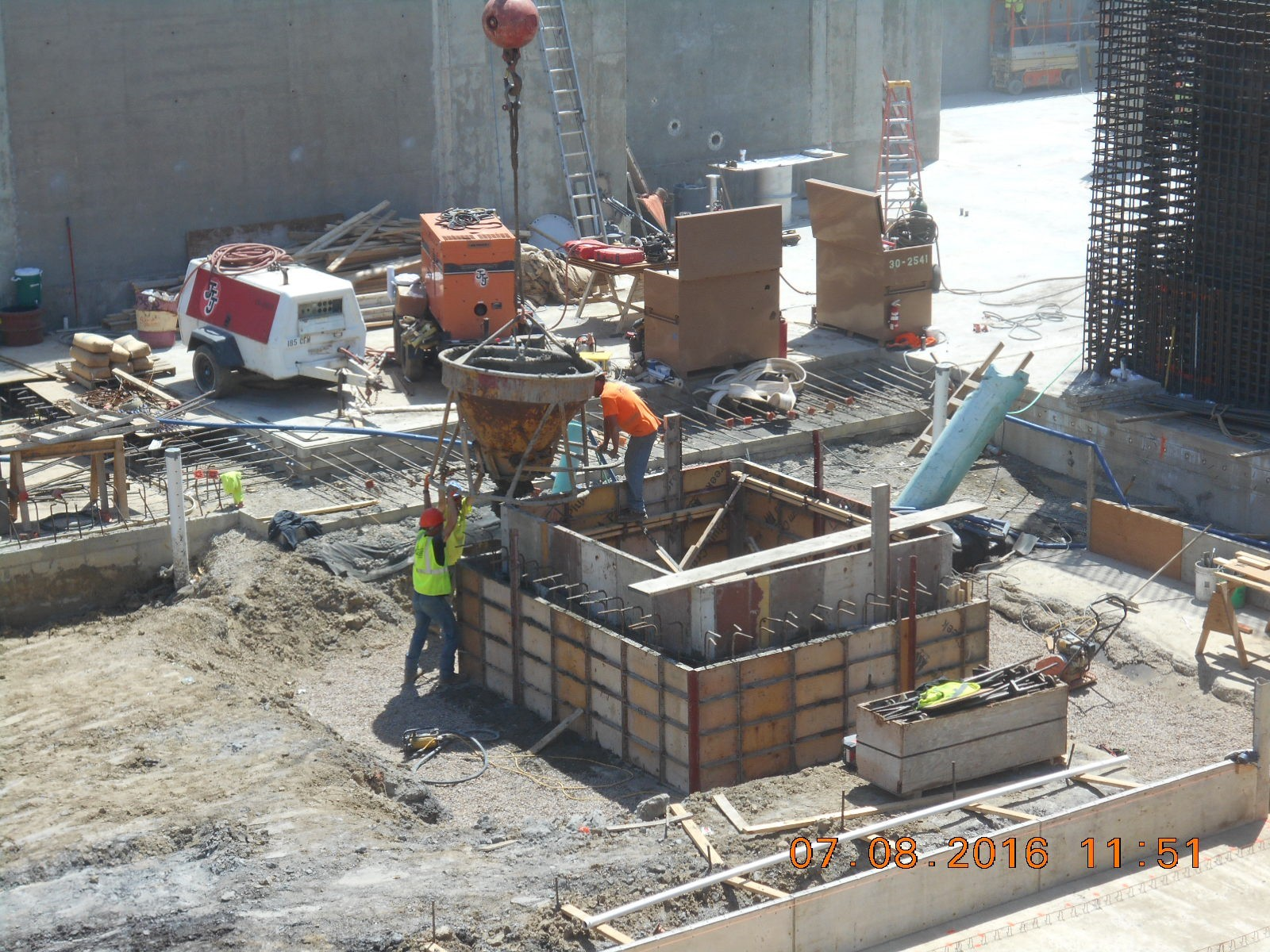 JTJ placing concrete for the elevator pit walls to elevation 2390.50'