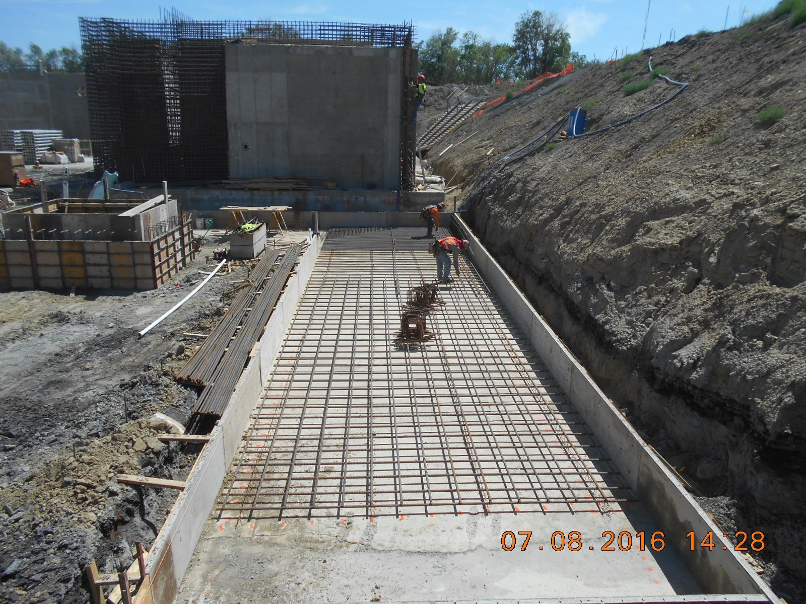 Harris Rebar placing the bottom mat of reinforcing steel for the west wall foundation.