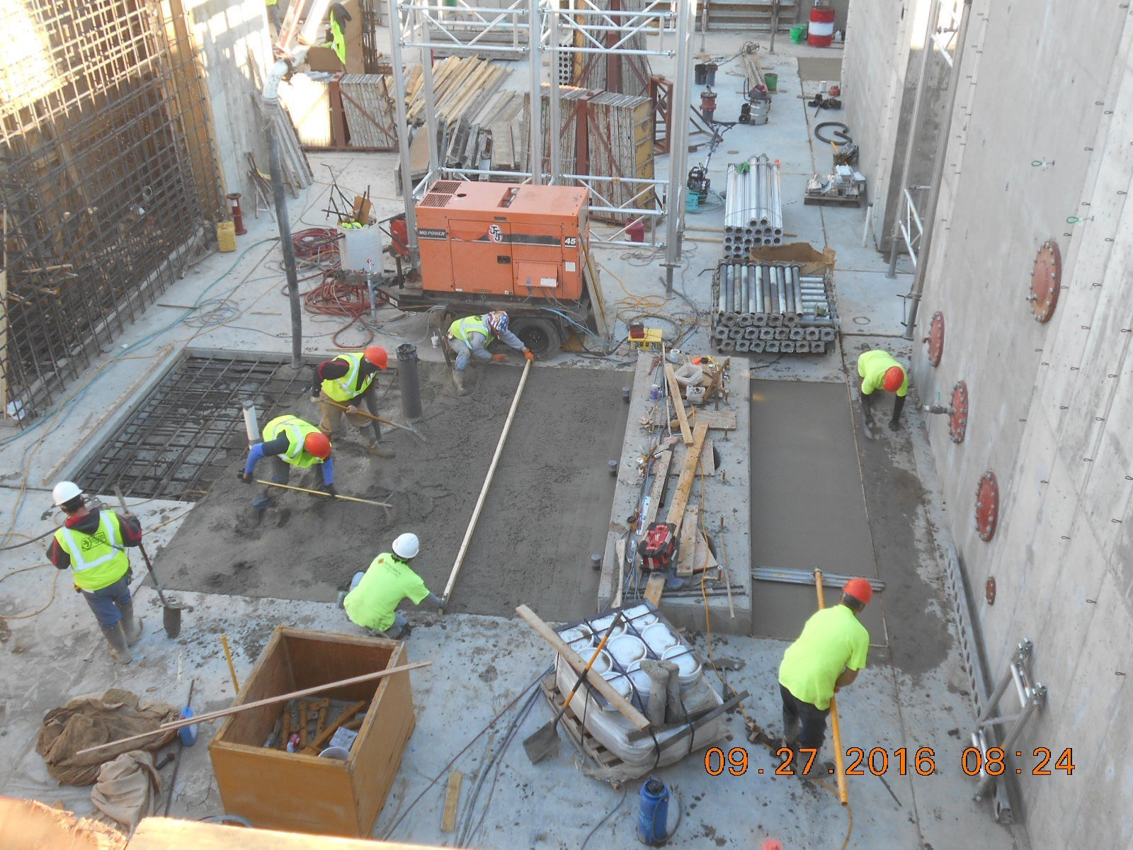 JTJ placing concrete for the basement floor slab, pour 28A.