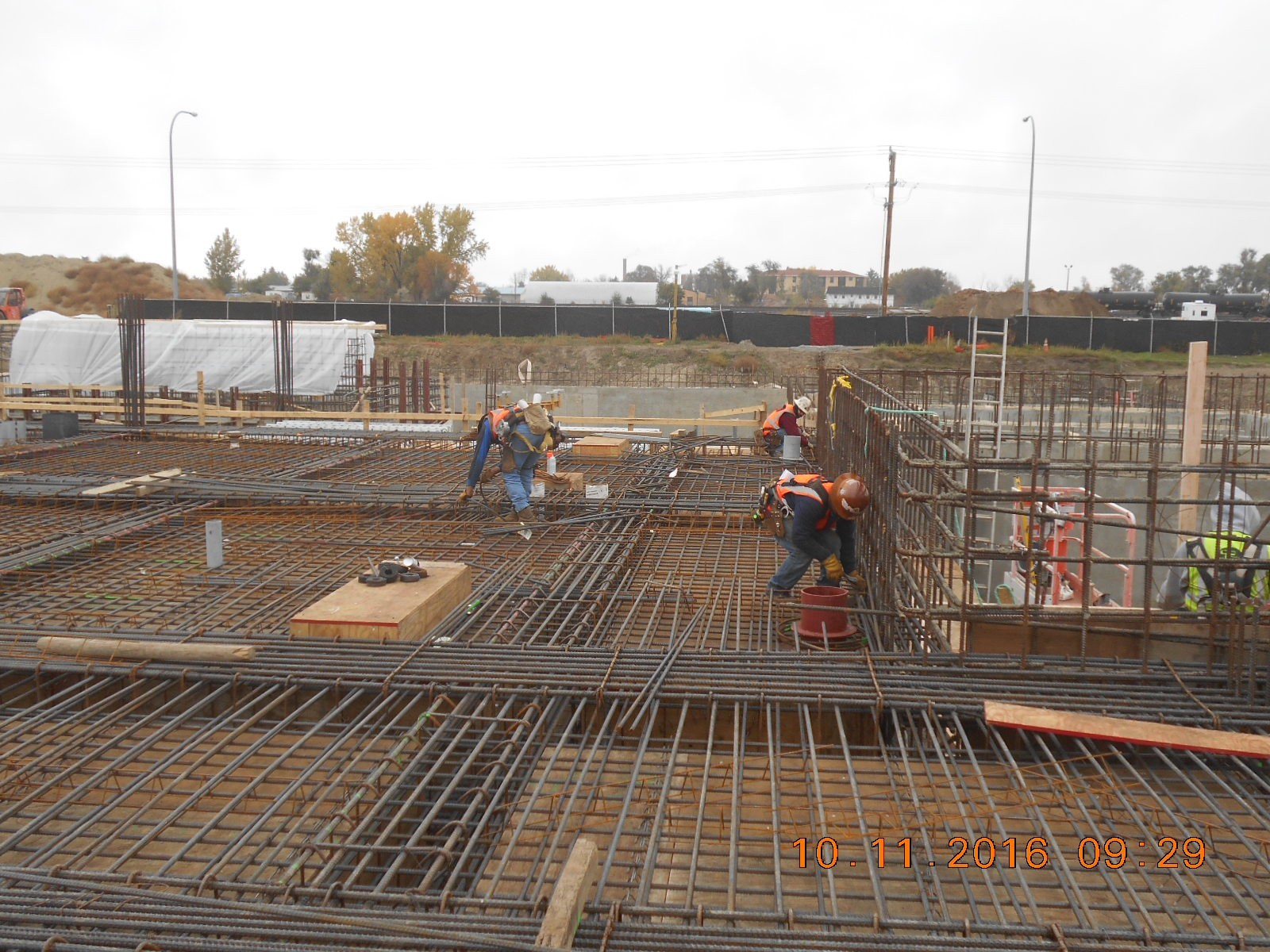 Harris Rebar placing the top mat of reinforcing steel for the first floor slab.