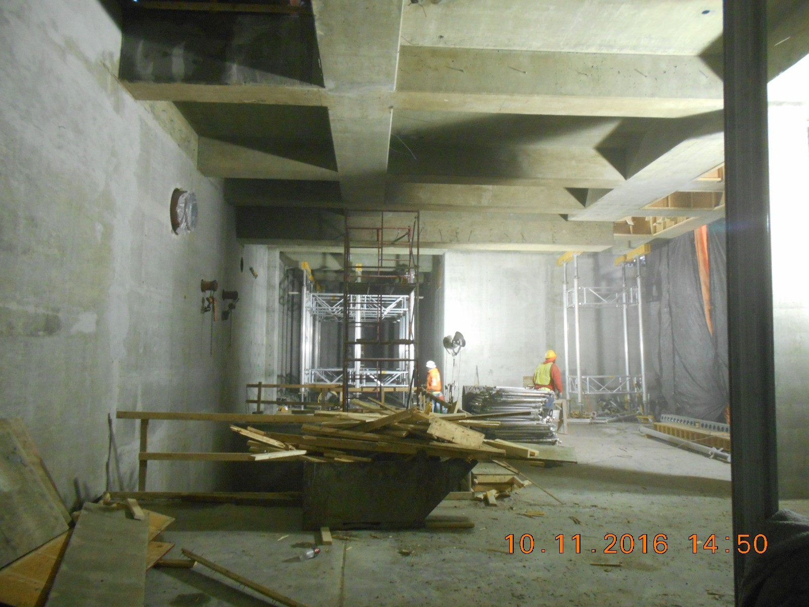 JTJ removing forms from the underside of the first floor slab and cleaning the Gallery area.