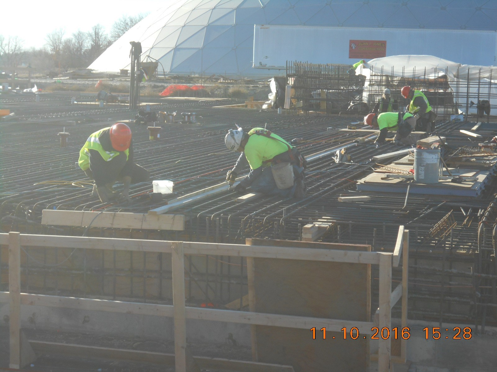 JTJ placing the bulkhead form for the construction joint along the north side of pour 3.