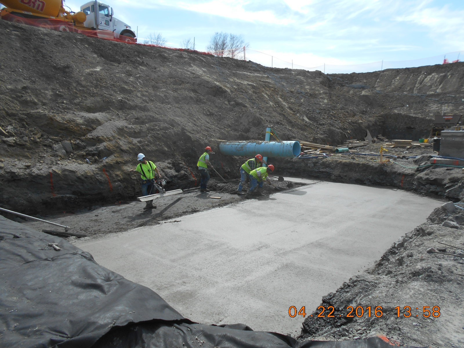 JTJ placing mud slab for Coag/Flood Drain Pit.