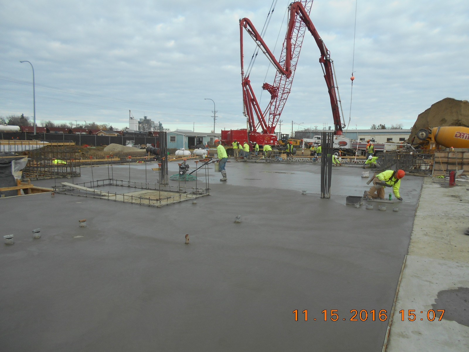 JTJ finishing the concrete for the first floor slab, pour 3.