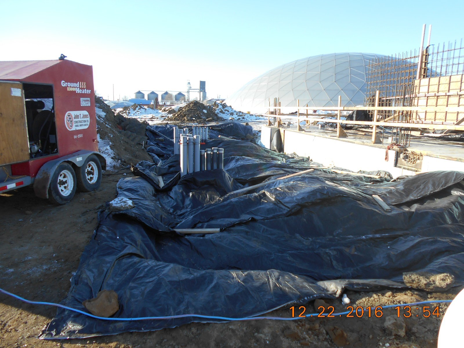Ground thaw and blankets placed to protect the ground from frost in preparation for construction of the concrete pads.