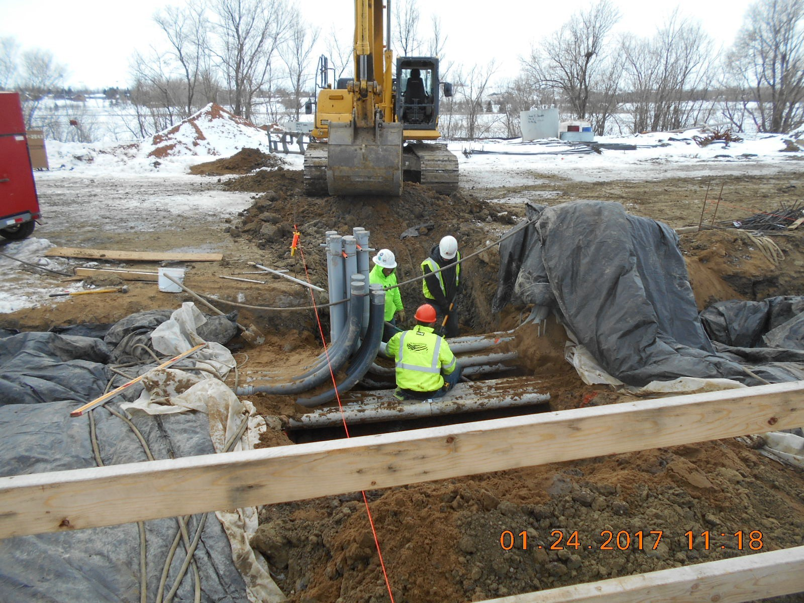 JTJ placing shoring and decking for the weir wall along the south side of the clarifier.