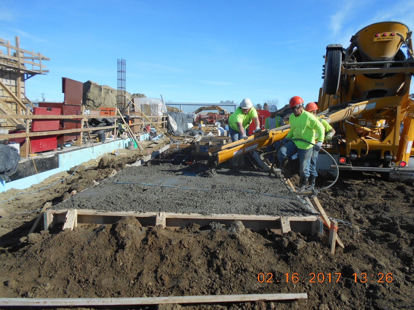 JTJ placing concrete for the generator pad.