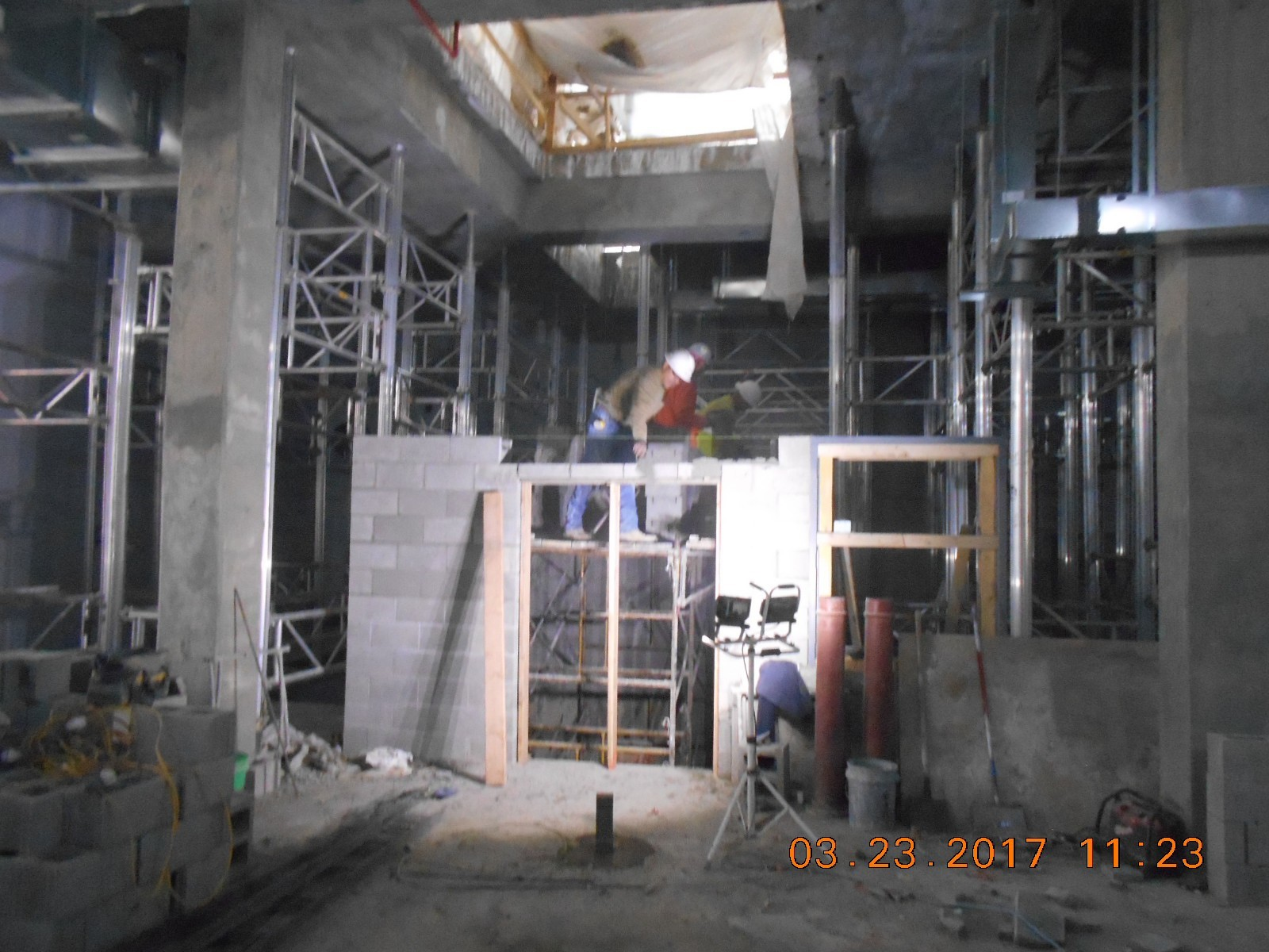 Olheiser Masonry placing concrete block for the elevator shaft in the basement gallery.