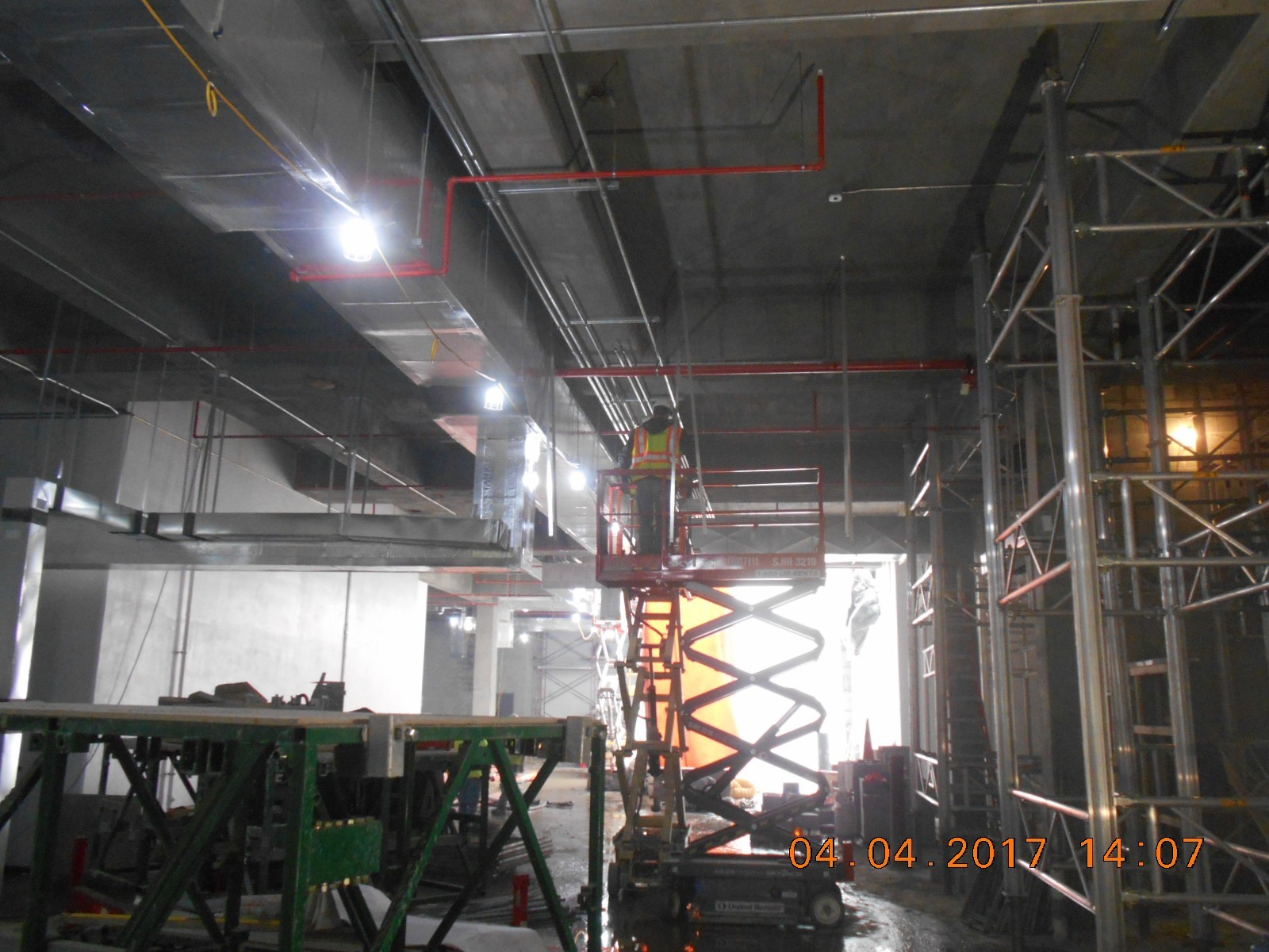 Edling Electric installing conduit in the basement gallery.
