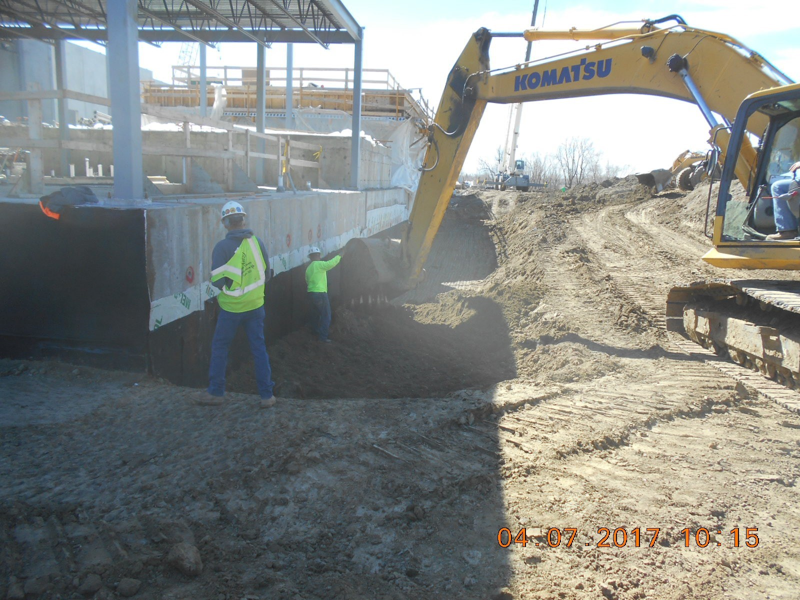 JTJ placing structural backfill along the west side of the building.