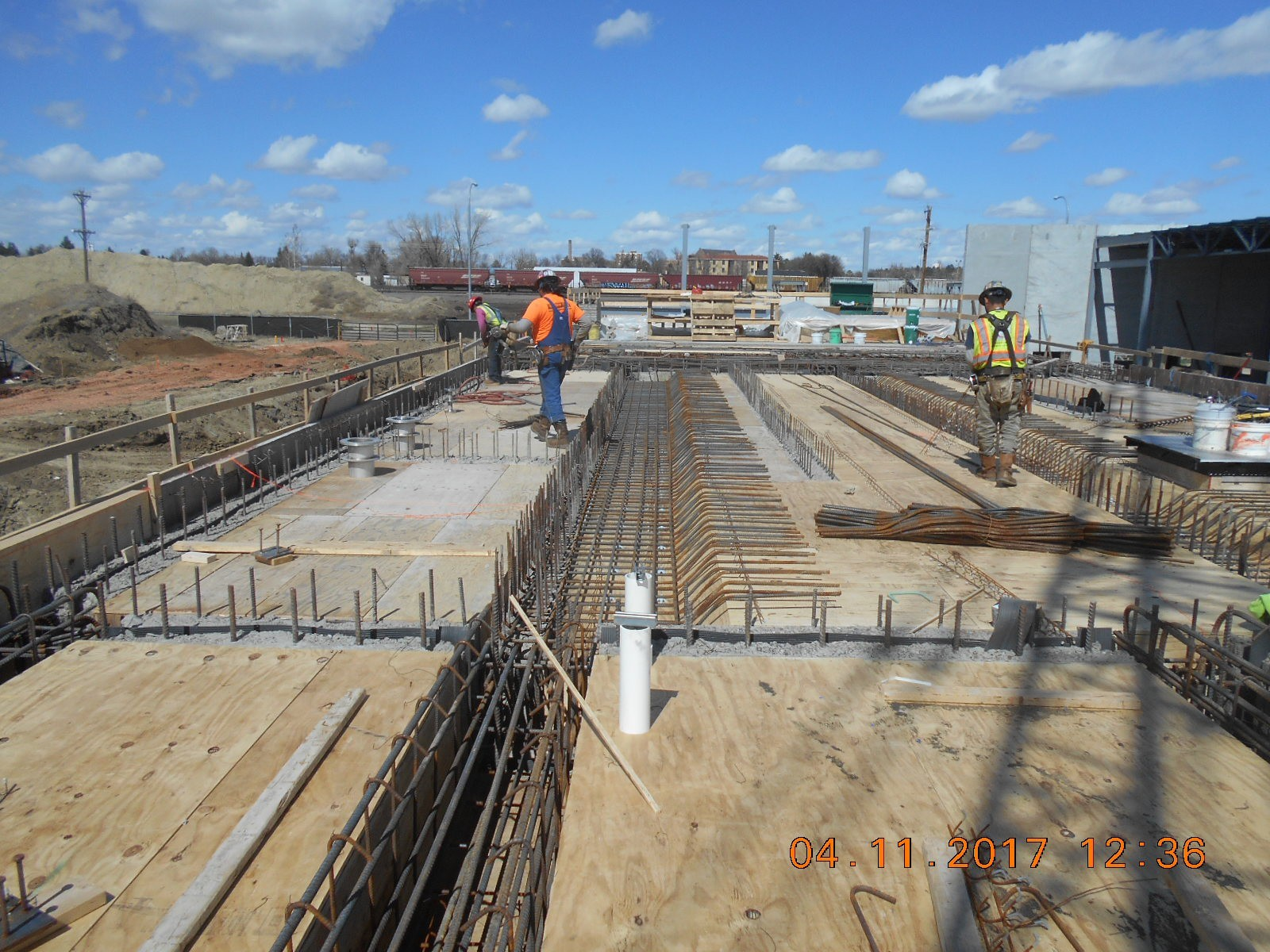 Harris Rebar placing the reinforcing steel for the trench drains in the top slab of the ozone basin.