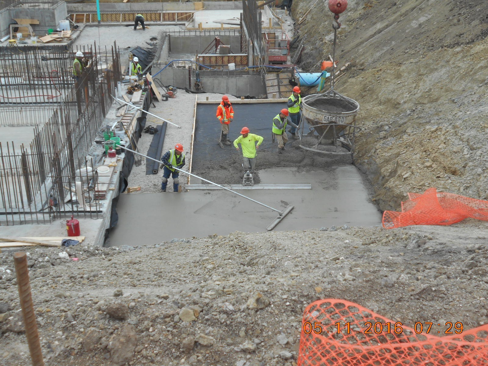 JTJ placing the concrete mud slab at the southwest corner of the building.