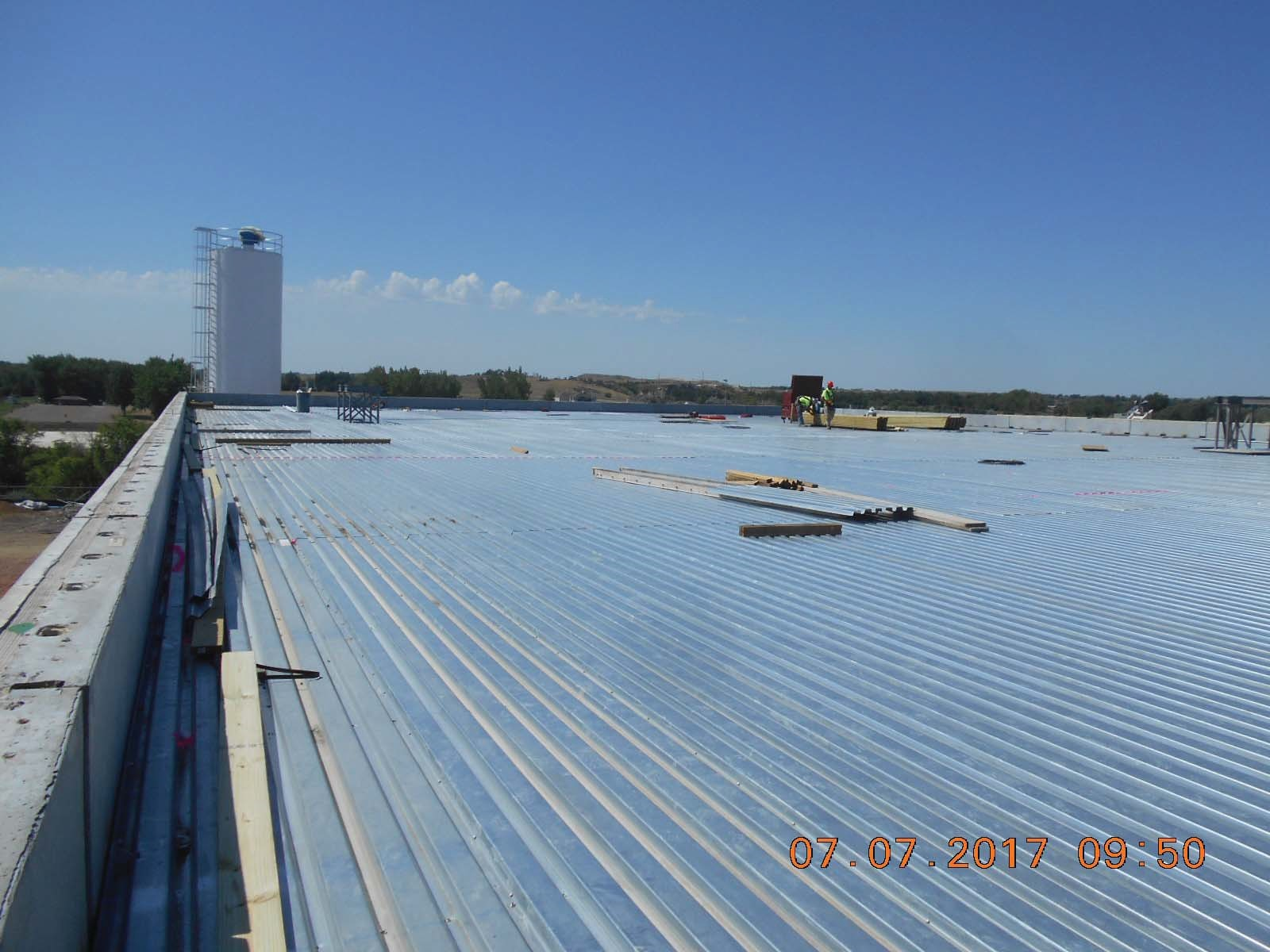 Looking southwest at the completed metal decking for the building roof.