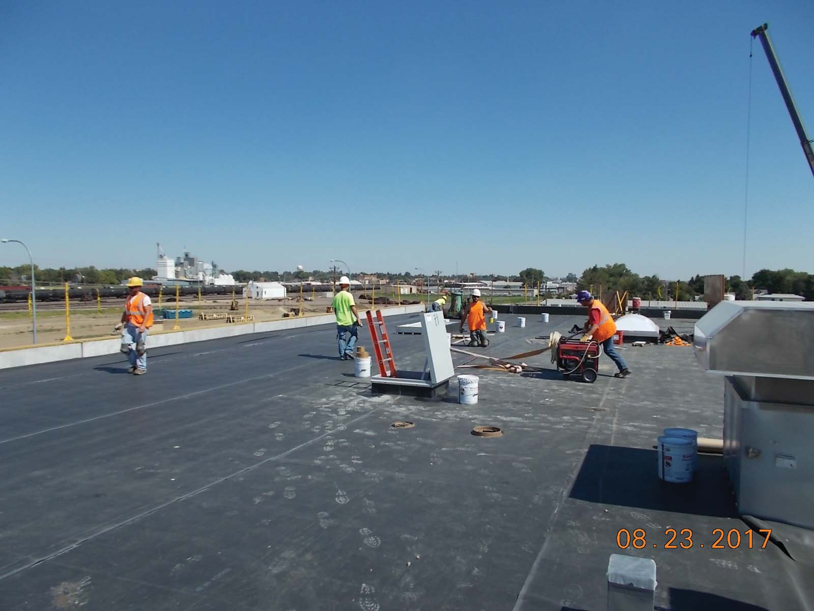 Twin City Roofing installing the rubber membrane for the roof at the north end of the building.