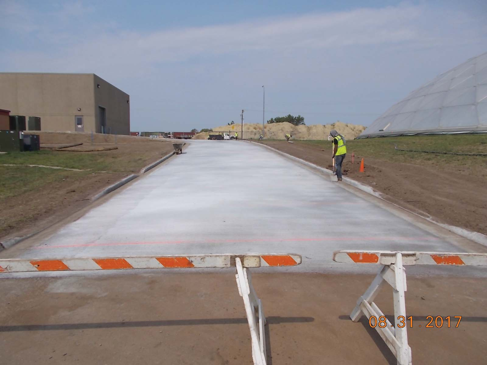 Looking north at the finished concrete for the east drive of the finished water pump station.
