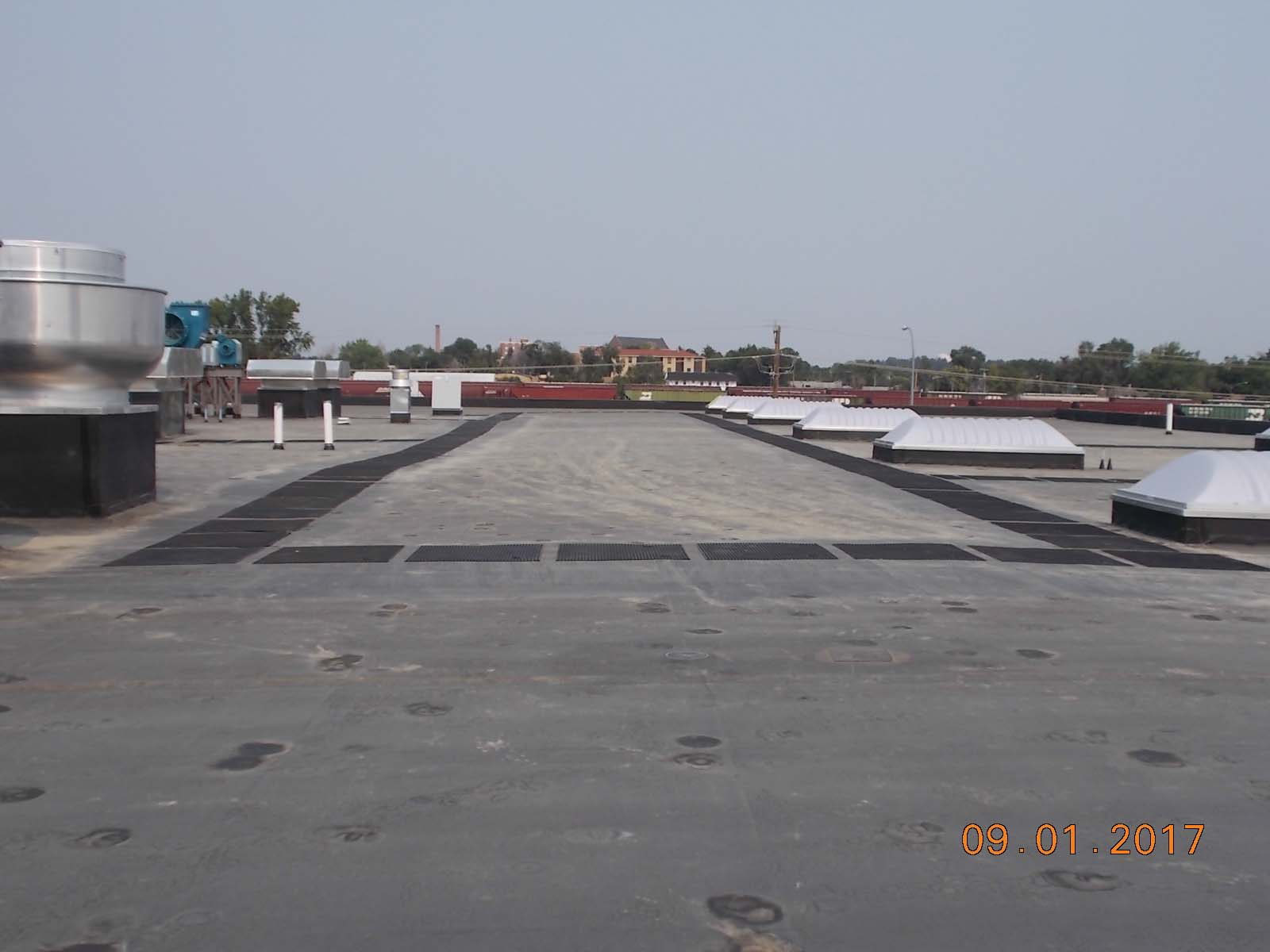 Looking north at the walkway pads installed on the roof by Twin City Roofing.