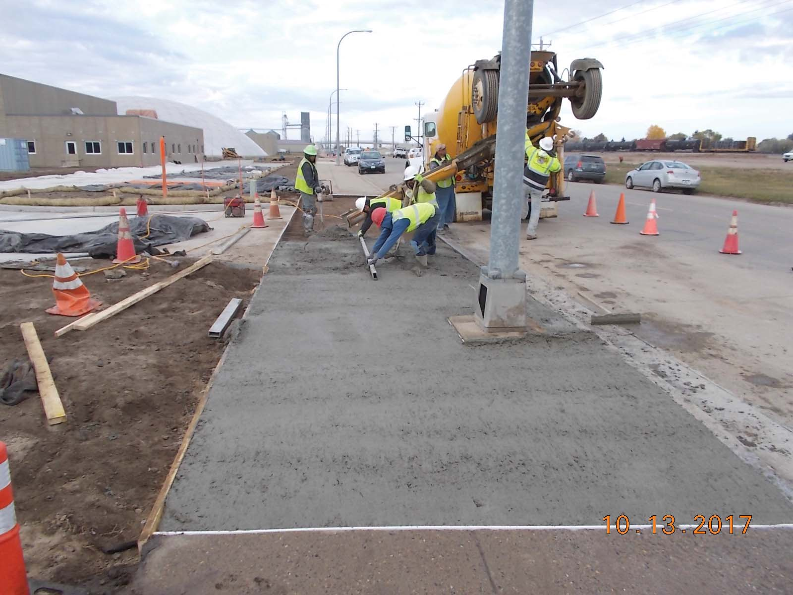 Winn Construction placing concrete for the east drive approach slab.
