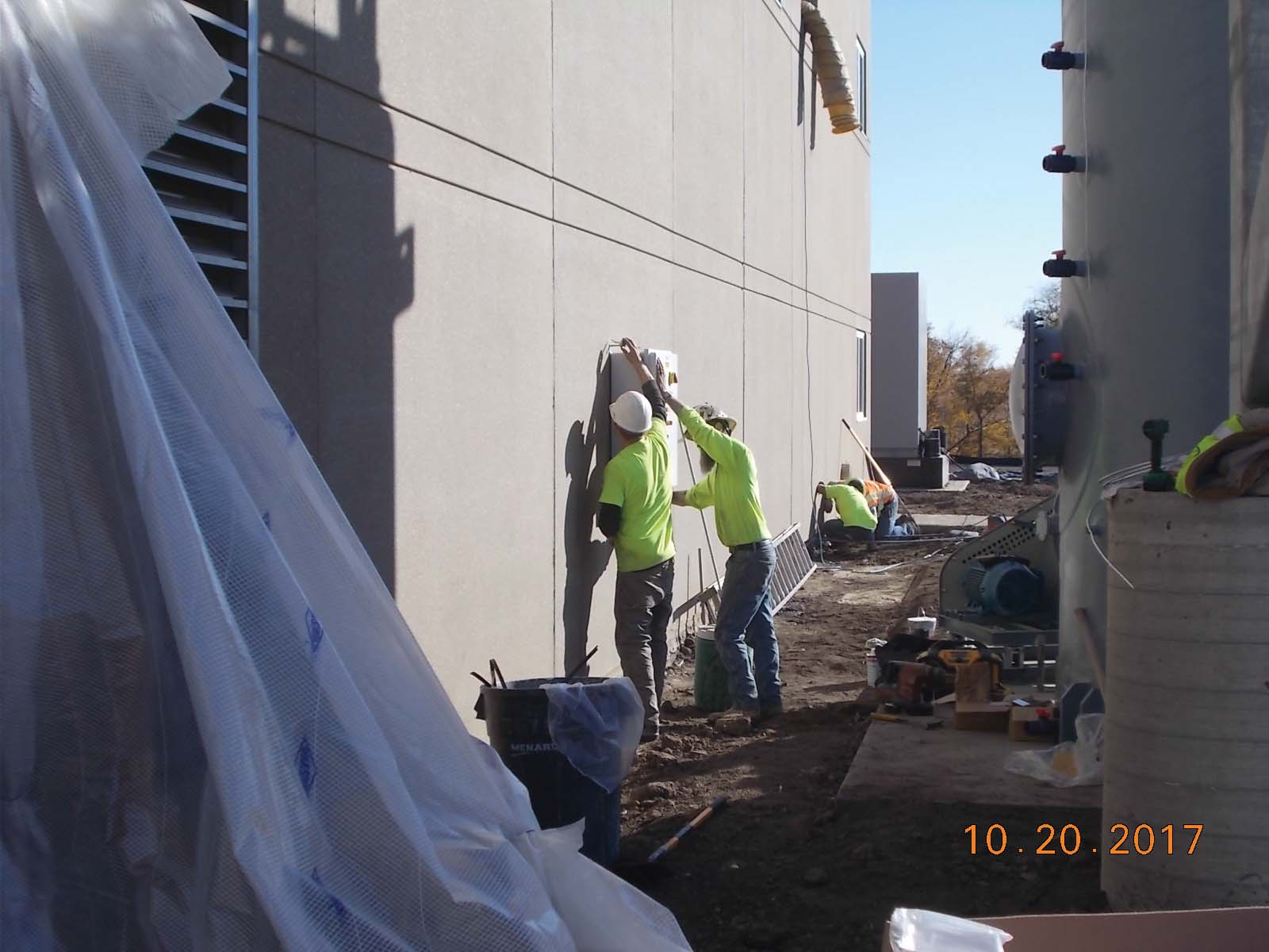 JTJ installing the control panel for the scrubber on the west wall of building.