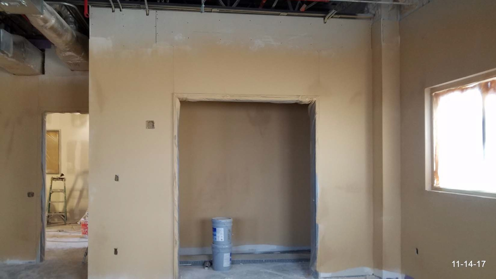 Fireproofing applied to the conference room walls.
