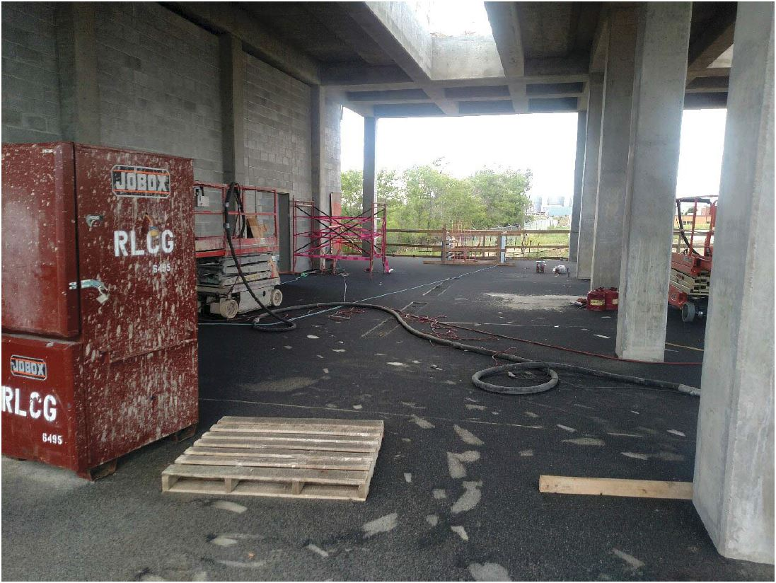 Protech began sandblasting the bottom of the second floor slab and the first floor columns.