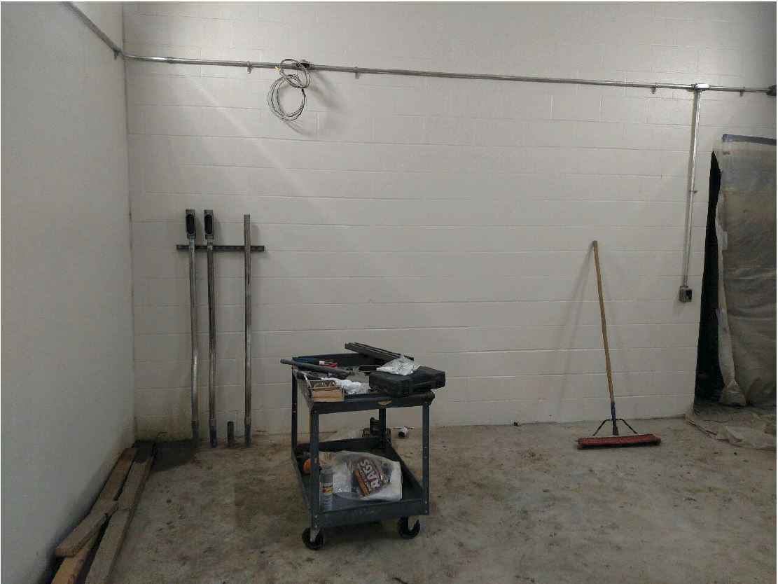 Edling Electric started placement of conduit from the basement pump room to the first floor.