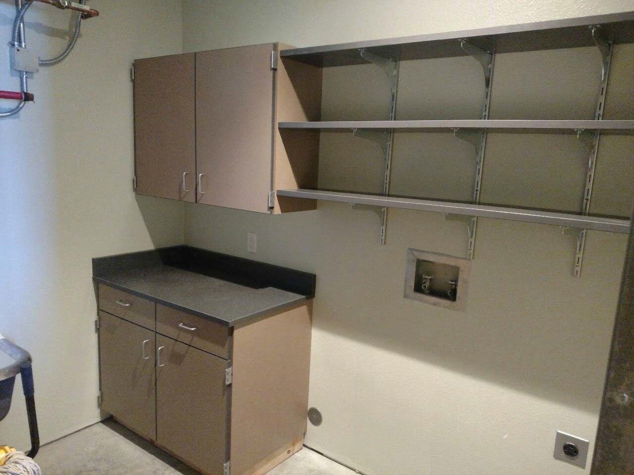 Cabinets installed in the admin utility room.