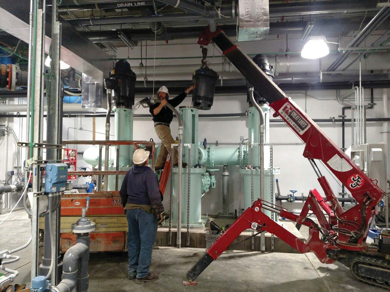 Watersmith installing the center vertical turbine pump motor.