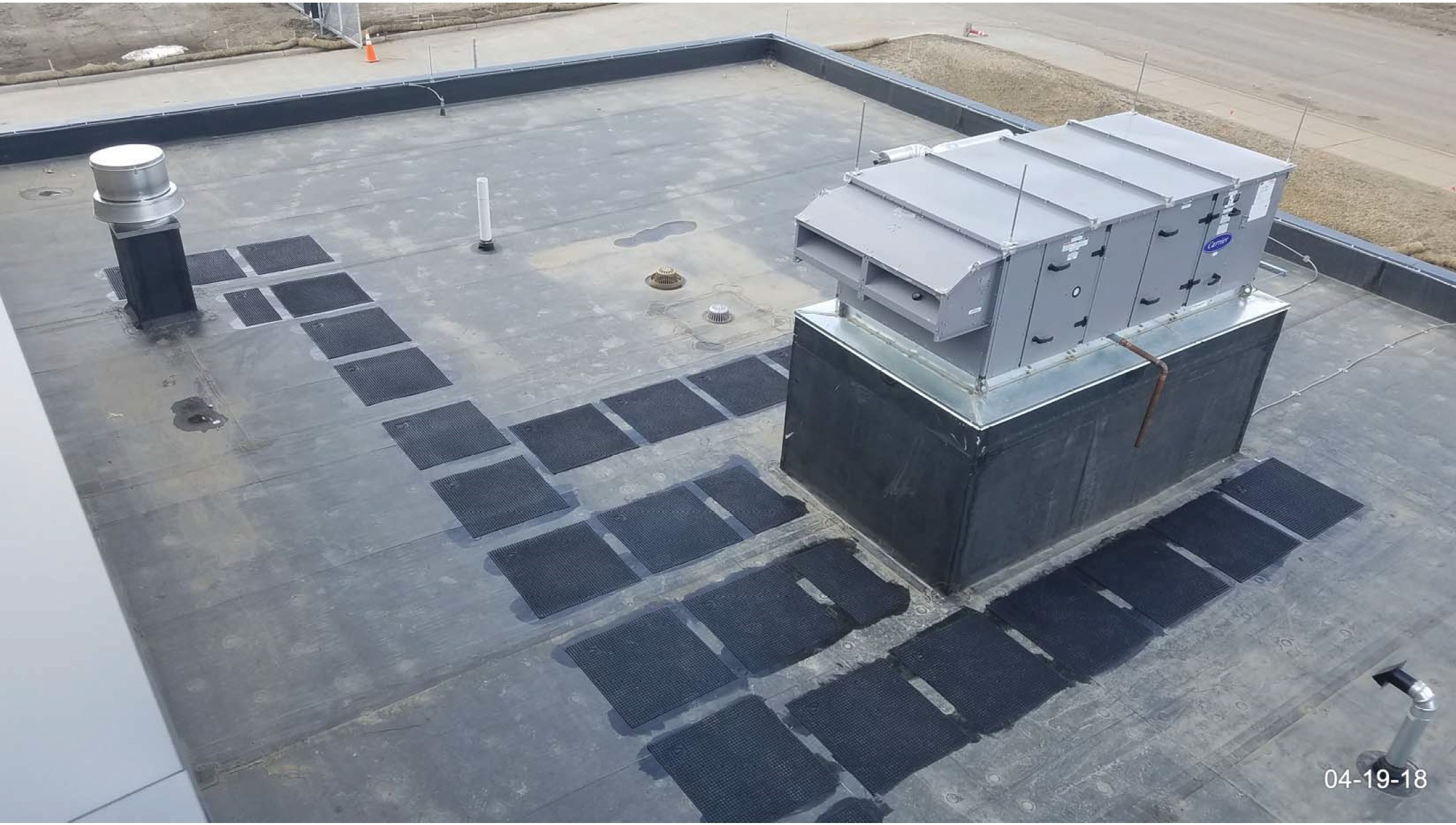 Walk pads installed on the admin roof.
